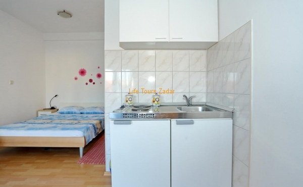 mini kitchen with double bed